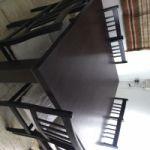 Vendo mesa negra cuadra con 8 sillas